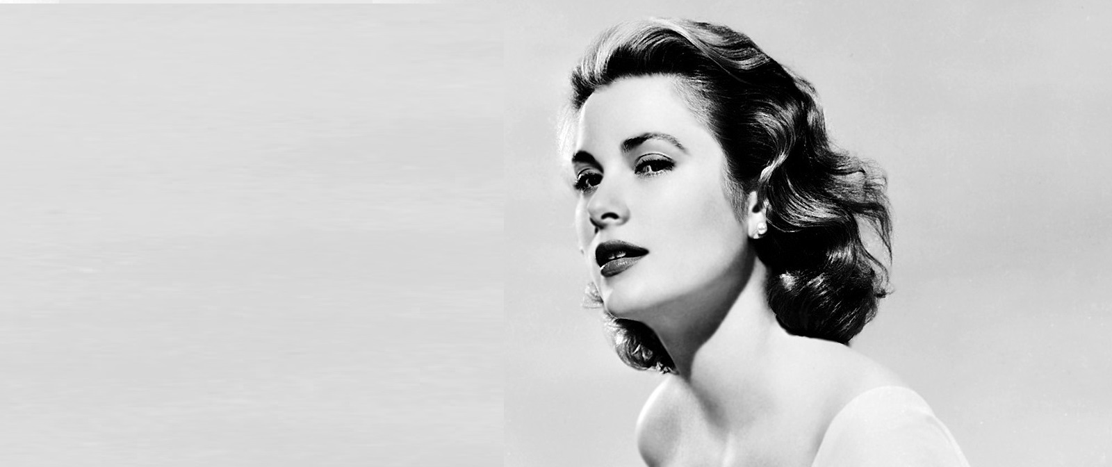 circa 1953:  American actress Grace Kelly (1929 - 1982) wearing a flowing white gown with a low neckline.