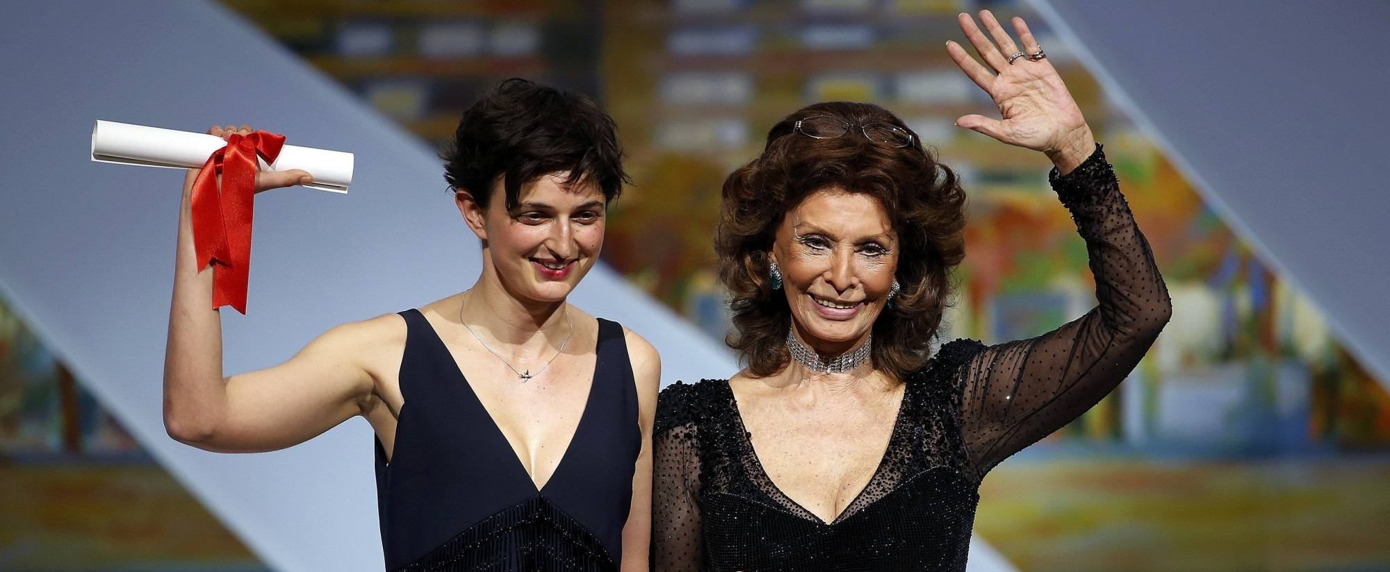 "Director Alice Rohrwacher, Grand Prix award winner for her film ""Le meraviglie"", poses on stage with actress Sophia Loren during the closing ceremony of the 67th Cannes Film Festival in Cannes"