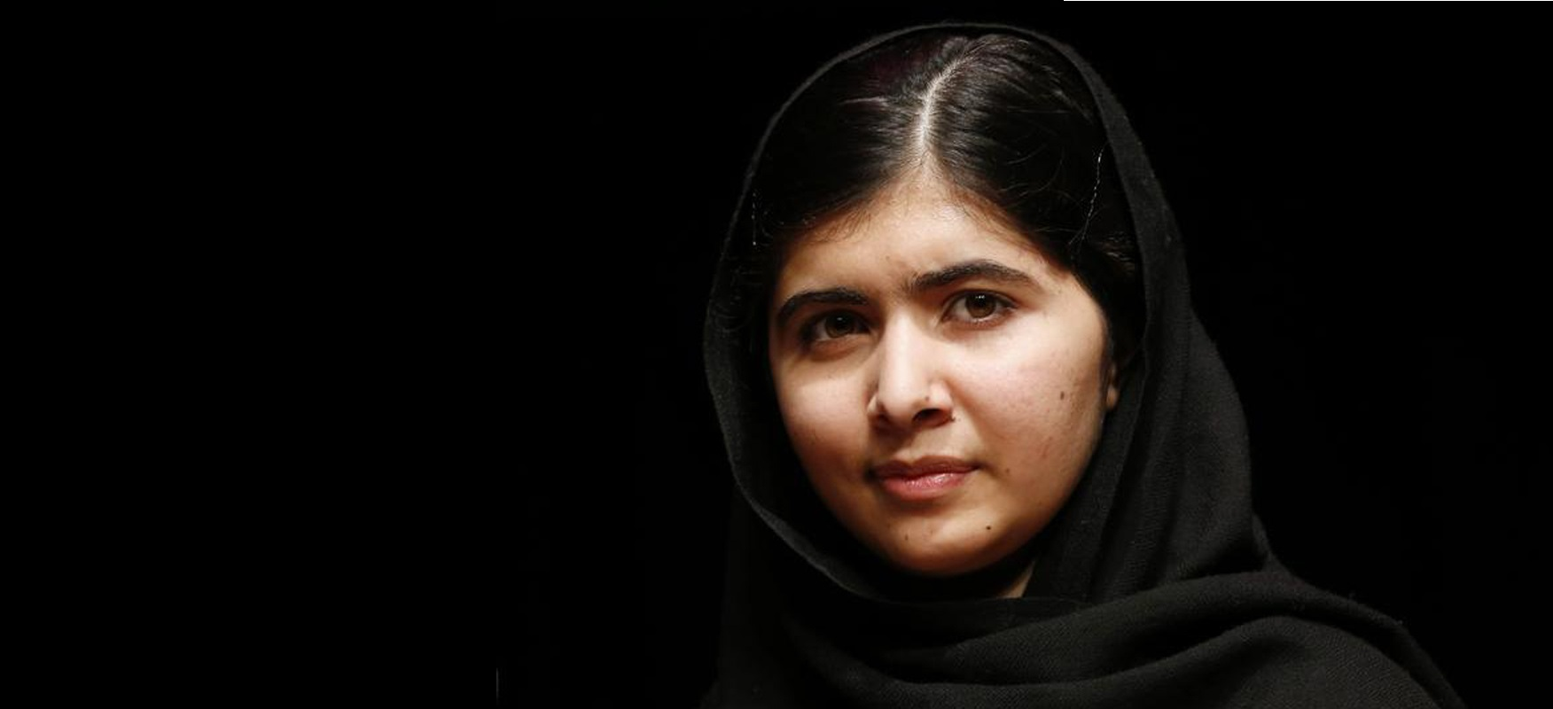 """Pakistani teenage activist Yousafzai poses for pictures before an event launching her memoir """"I Am Malala"""" in London"""