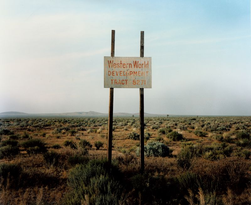 17. Wim Wenders Western World Development, Near Four Corners, California © for the reproduced works and texts by Wim Wenders: Wim Wenders/Wenders Images/Verlag der Autoren 1986 C - Print 124.6 x 142.2 cm