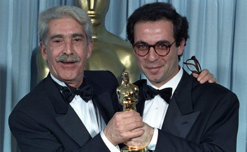 Franco Cristaldi e Giuseppe Tornatore con l'Oscar nel 1990