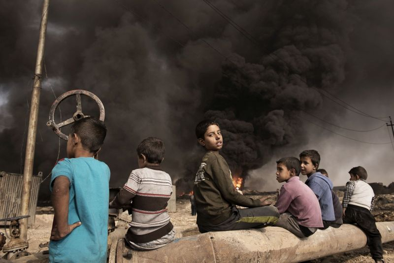 Iraq, Qayyara: On October 2016 children are seen in Qayyara where IS fighters set on fire crude oil fields as they retreated. Alessio Romenzi