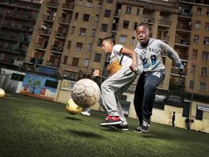 Baranzate, 2019: Progetto Kiriku. Il gioco fuori casa. Oratorio - gioco calcio © Gerald Bruneau