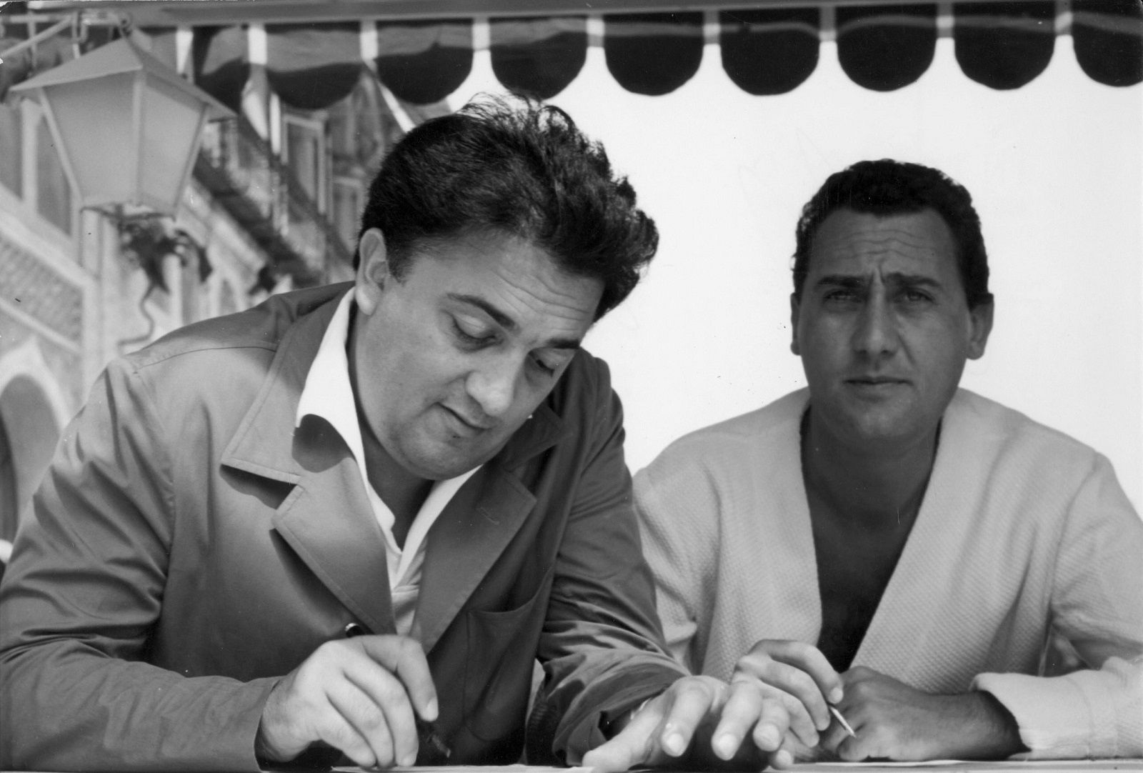 Alberto Sordi, Federico Fellini at the Venice Film Festival 1953- In case of set scenes, it is forbidden to reproduce the photograph out of context of the promotion of the film. It must be credited to the Film Company and the photographer assigned by or authorized by on the set by the Film Company.