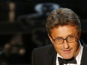 Director Pawel Pawlikowski holds his Oscar for best foreign language film at the 87th Academy Awards in Hollywood, California